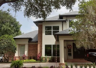 New Seamless Gutters and Rain Chain Installed on Beautiful Home in Tampa